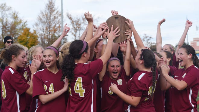 The Arlington girls soccer team celebrates after winning the Class AA regional final against Monroe-Woodbury.