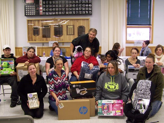 Tioga County parents with door prizes they won during