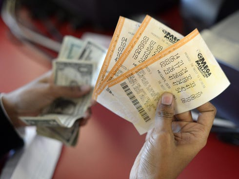 A customer purchases Mega Millions lottery tickets in Tallapoosa, Ga., Tuesday.