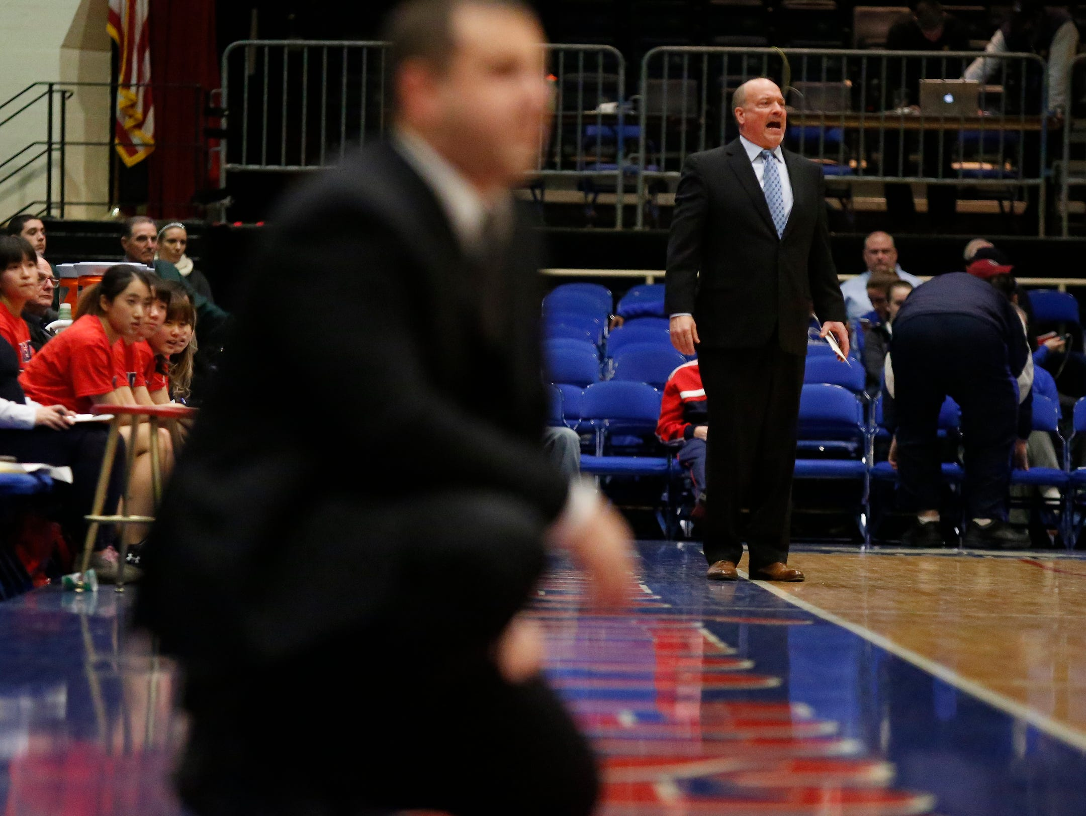 Keio head coach Steven Loscher, right, instructs players from the sideline during their 46-31 win over North Salem in the class C semi-final basketball game at the Westchester County Center in White Plains on Saturday, February 27, 2016.