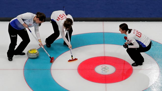 Becca Hamilton of the United States sweeps in front of the stone in the Women's Curling Round Robin during the Pyeongchang 2018 Olympic Winter Games at Gangneung Curling Centre.