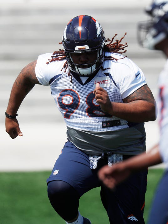 FILE - In this Saturday, May 13, 2017, file photo, Denver Broncos nose tackle Tyrique Jarrett rolls through a drill during the team's NFL football rookie minicamp at the Broncos' headquarters in Englewood, Colo. (AP Photo/David Zalubowski, File)