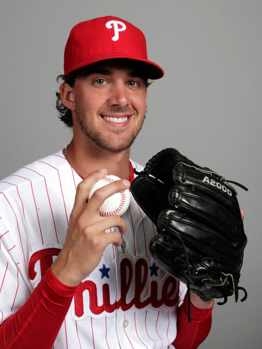 """File-This Feb. 20, 2018, file photo shows Aaron Nola of the Philadelphia Phillies baseball team. Gabe Kapler isn't one to wait. Nola will be his first opening-day starter as Philadelphia Phillies manager. """"Barring anything crazy happening, he's our guy. He is the man,"""" Kapler said after Nola pitched two innings in his spring-training debut Sunday, Feb. 25, 2018, an 8-3 loss to the New York Yankees. (AP Photo/Lynne Sladky, File)"""