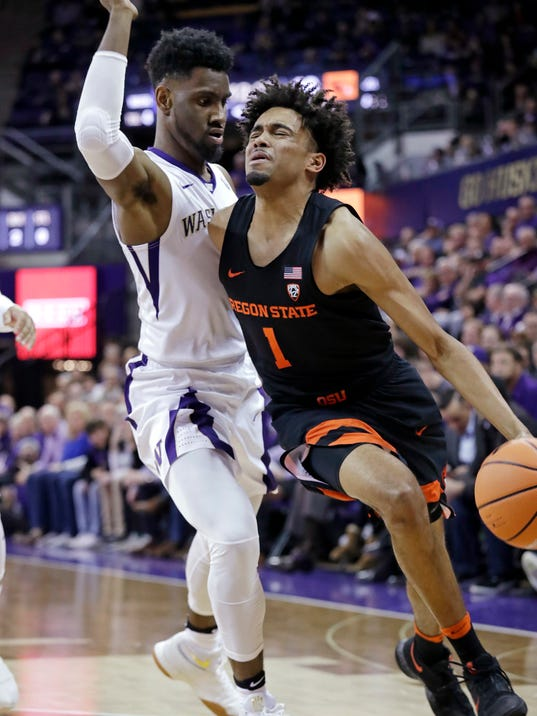 Oregon State's Stephen Thompson Jr., right, reacts while being fouled by Washington's Jaylen Nowell during the first half of an NCAA college basketball game Thursday, March 1, 2018, in Seattle. (AP Photo/Elaine Thompson)