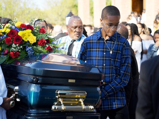 The casket of Keithan Whitmire, 15, is placed into a hearse following the funeral service April 27, 2018.