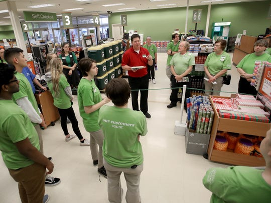 Store manager Mark Wiegel gives store personnel their