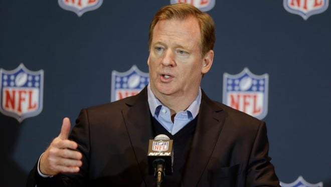 NFL Commissioner Roger Goodell answers questions during a news conference at the NFL annual meeting in Orlando, Fla., on  Wednesday. The league is looking into playoff expansion.