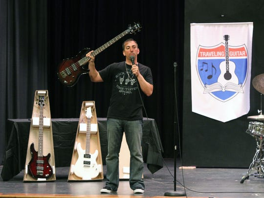 Damon Marks and the Traveling Guitar Foundation go to schools that have had their arts budgets cut and give lessons, put on a show and donate new instruments. He was at the Theodore Schor Middle School in Piscataway on Friday.