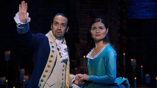 "Lin-Manuel Miranda stars as Alexander Hamilton and Phillipa Soo is Eliza Hamilton in ""Hamilton,"" the filmed production of the Broadway musical available on Disney+"