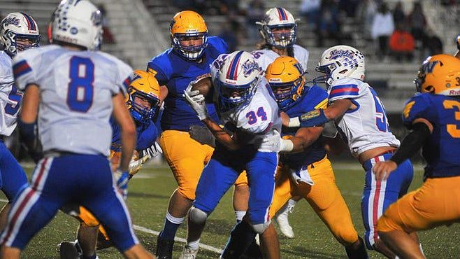 Wooster's defensive line engulfs West Holmes running back Emmett Myers during the Generals 34-17 win Friday night. The Daily Record / Kayla Myers