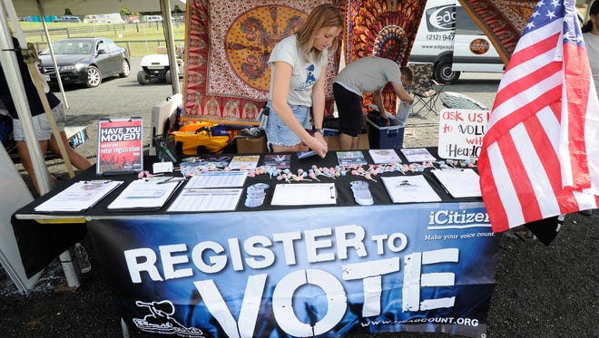 Macy Nix, left and Evan Rose get ready to register voters at the Lockn' Music Festival in Arrington, Va.