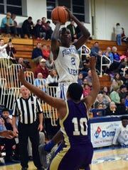 Robert E. Lee's Darius George goes up for a shot over Waynesboro's DaJuan Moore during the first half of their Valley District game at Robert E. Lee High School in Staunton on Friday, Feb. 3, 2017.