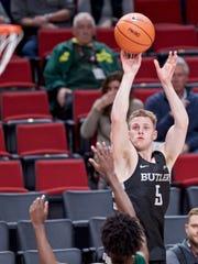 Butler guard Paul Jorgensen, right, shoots over Portland