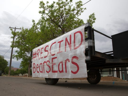 A sign to rescind Bears Ears National Monument is posted, Tuesday, May 9, 2017, in front of a resident's home in Blanding Utah.