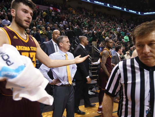 Arizona State's Roman Vila, left, and coach Bobby Hurley look for a call from the officials after the buzzer sounded to end the team's NCAA college basketball game against Oregon on Thursday, Feb. 2, 2017, in Eugene, Ore. (AP Photo/Chris Pietsch)