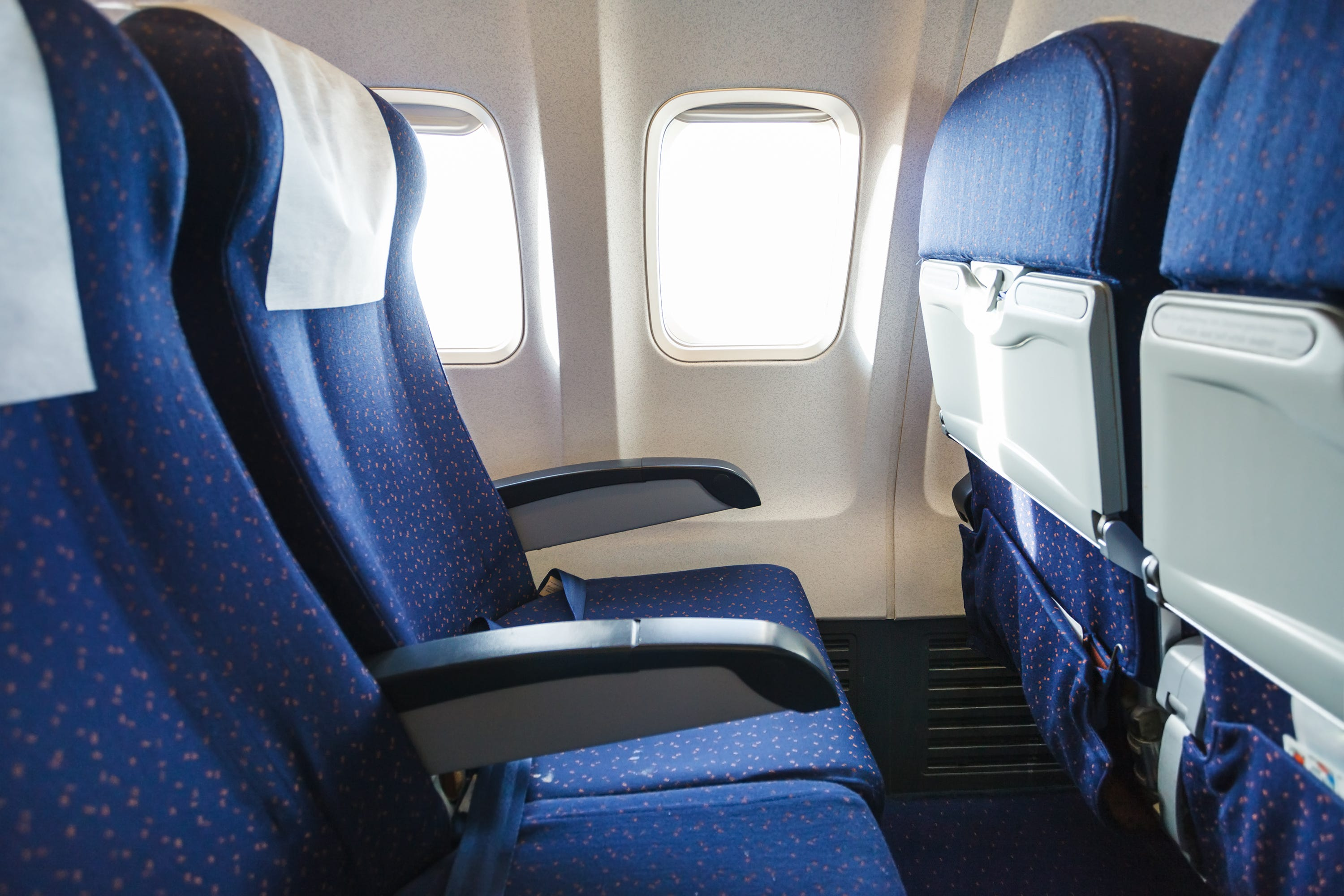 Where to sit on an airplane to avoid catching a cold photo