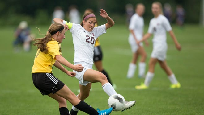 Dowling High School's Bailey Bravard steals the ball from Bettendorf's Tessa Wright in the first half Thursday, June 11, 2015, during the IHSAA State Soccer Championships at Cownie Sports Complex in Des Moines.