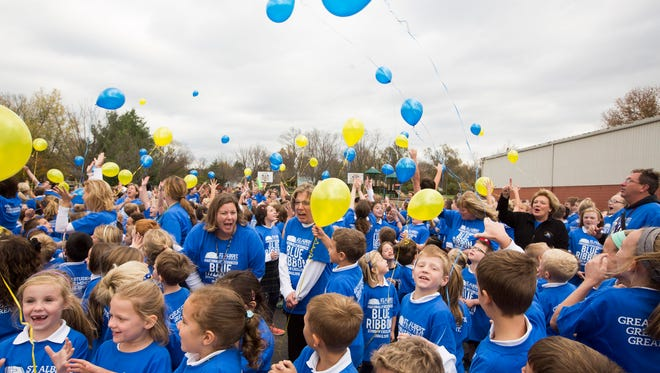 Students and staff celebrated the achievement by releasing balloons.