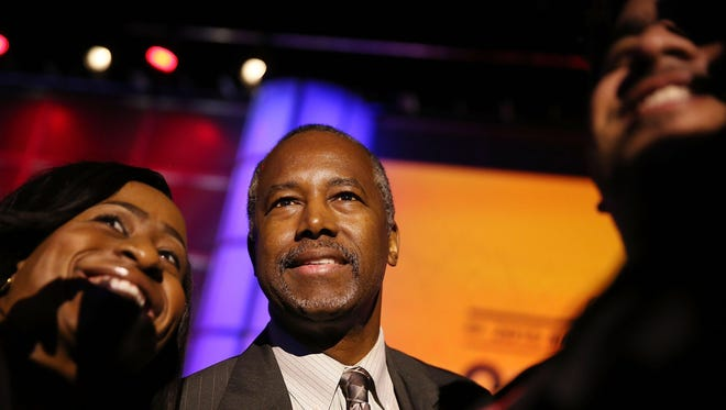 Republican Presidential hopeful Ben Carson greets people during the Presidential Candidates Plenary at the National Urban League conference in the Fort Lauderdale Convention Center on July 31, 2015 in Fort Lauderdale, Florida.