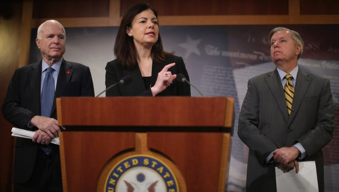 Sens. Kelly Ayotte, Lindsey Graham and John McCain hold a news conference at the U.S. Capitol on Feb. 24, 2016, in Washington.