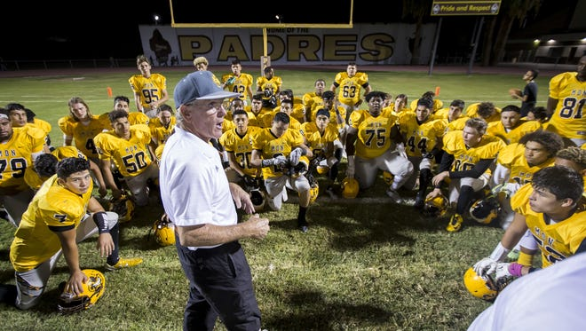 Marcos de Niza head coach Paul Moro speaks to his team following the high school football game between Cactus Shadows and Marcos de Niza at Marcos de Niza high school on Friday, October 7, 2016 in Tempe, Arizona. Moro tied the state record with 331 career wins after defeating Cactus Shadows 34-21.