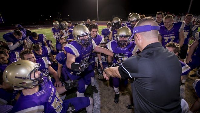 Notre Dame Prep head coach Mark Nolan speaks to his team following the high school football game between Paradise Valley and Notre Dame Prep at Notre Dame Prep on Thursday, October 6, 2016 in Scottsdale, Arizona.