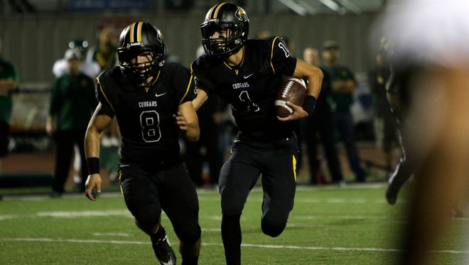 Ventura's Angel Moreno leads the way for quarterback Jack Gutierrez during last Friday night's playoff win over Moorpark. The Cougars host Capistrano Valley in a Division 5 quarterfinal game Friday.