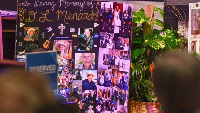 Friends and family say goodbye to D.L. Menard during Funeral Services held at Family Life Church . Monday, July 31, 2017.