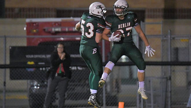 Alex Olofson (27) of Berlin celebrates with Richard McMartin (53) after scoring a touchdown Friday against Campbellsport.