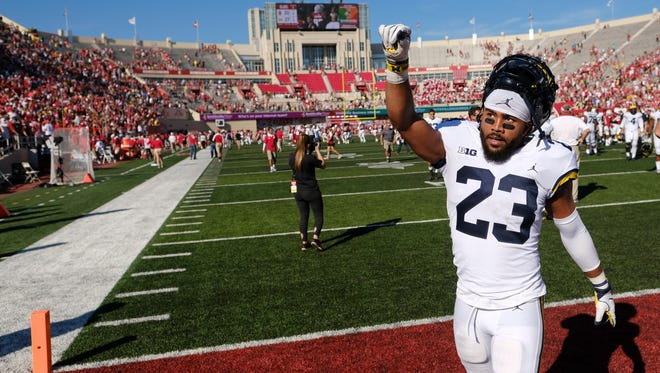 Michigan defensive back Tyree Kinnel gestures to the crowd after the Wolverines' 27-20 win over Indiana last Saturday. Kinnel's interception in overtime sealed U-M's 27-20 win.