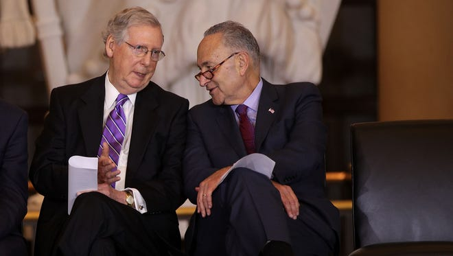 U.S. Senate Majority Leader Sen. Mitch McConnell (R-KY), left, chats with Senate Minority Leader Sen. Chuck Schumer (D-NY) during a Congressional Gold Medal presentation ceremony October 25, 2017 at the U.S. Capitol Visitor Center in Washington, DC. The medal is to honor Filipino veterans of World War II for their service and sacrifice during the war.