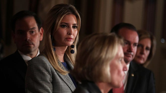 Sen. Shelley Moore Capito, R-W.Va., speaks as Sen. Marco Rubio, R-Fla., Ivanka Trump, Sen. Mike Lee, R-Utah, and Rep. Claudia Tenney, R-N.Y., listen during a news conference on Oct. 25, 2017, at the Capitol.