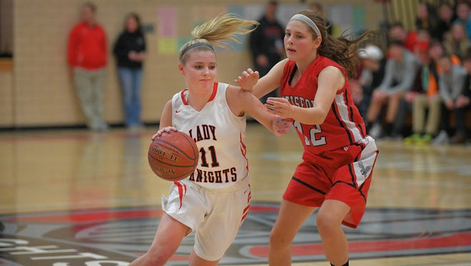 Alexis Rolph (11) of Lourdes drives past Julia Leinen (12) of Hustisford in a Trailways East Conference matchup on Jan. 18. Rolph is the 2017-18 Oshkosh Northwestern All-Area Girls Basketball Team Player of the Year.
