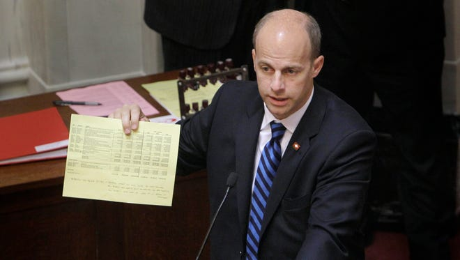 In this April 18, 2013, file photo, former Sen. Jake Files, R-Fort Smith, appears in the Senate chamber at the Arkansas state Capitol in Little Rock. Files, pleaded guilty Monday to federal charges of wire fraud, bank fraud and money laundering. Files was accused of misusing $25,000 in state money that had been set aside for local grants.