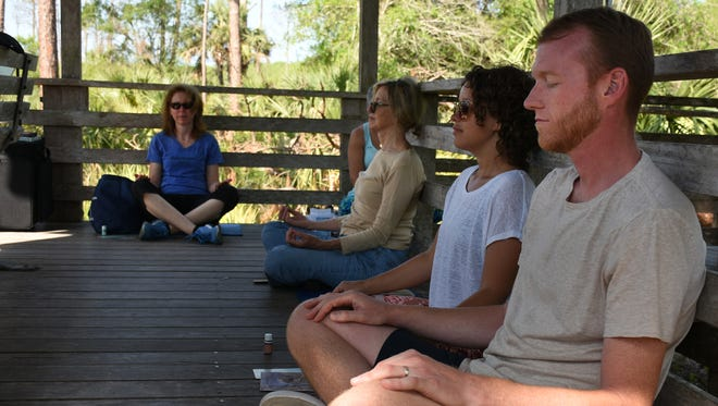 "Shane and Christy Duff of Naples enjoy the tranquility. Corkscrew Swamp Sanctuary is holding monthly ""Swamp Meditation"" sessions the first Saturday of the month, in the heart of the preserve."