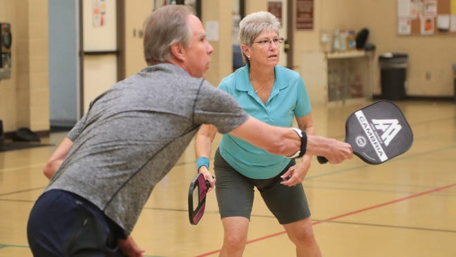 Greg Gehrich plays pickleball with teammate Mary Blackman at the James O. Jessie Center in Palm Springs, Calif., June 25, 2018.