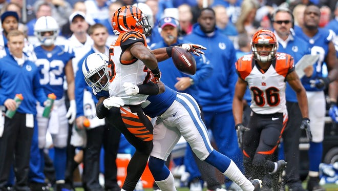 Colts CB Vontae Davis hits Bengals RB Giovani Bernard to break up a pass during the second quarter on Oct.19, 2014 at Lucas Oil Stadium.