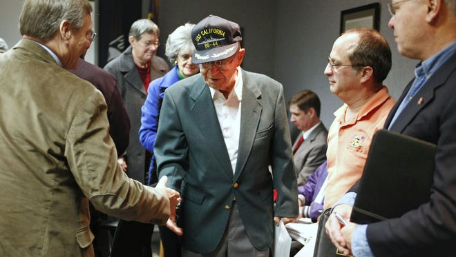 """Virgil Taylor shakes hands after he received a proclamation issued by Gov. Kitzhaber declaring """"Pearl Harbor Remembrance Day, on Wednesday, Dec. 7, 2011. Taylor, of Keizer, is a survivor of the Japanese attack on Pearl Harbor on Dec. 7, 1941."""