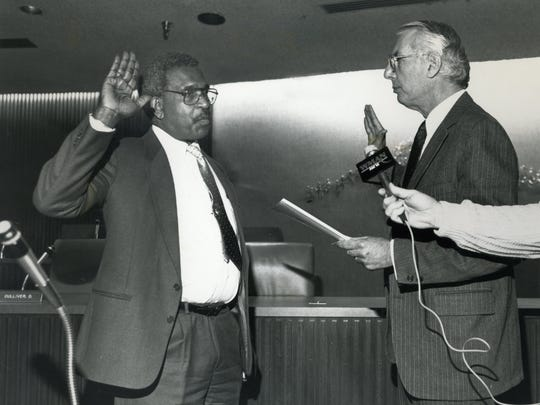 Lawrence Harper is sworn in as new police chief by Ed Meehan on January 19th, 1990.