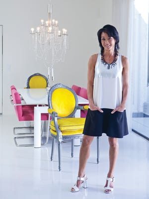 Deborah Chu Dejah sports on of her favorite collectibles: a vintage mini by Courreges. She loves the pockets. The black coral necklace she found at Flow Modern Design in Palm Springs. Prada sandals complete  the look.