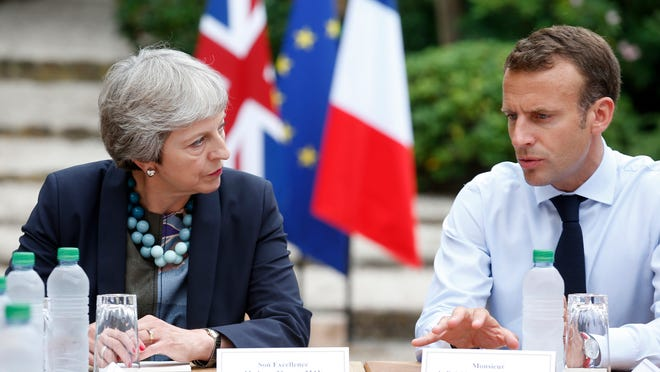 French President Emmanuel Macron, right, meets with British Prime Minister Theresa May to discuss Brexit issues at the Fort de Bregancon in Bornes-les-Mimosas, southern France, in August.