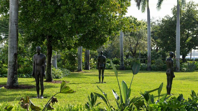 """Antony Gormley's """"Total Strangers IV, V and VI"""" are among the 17 sculptures on view in the Norton Museum's sculpture garden."""