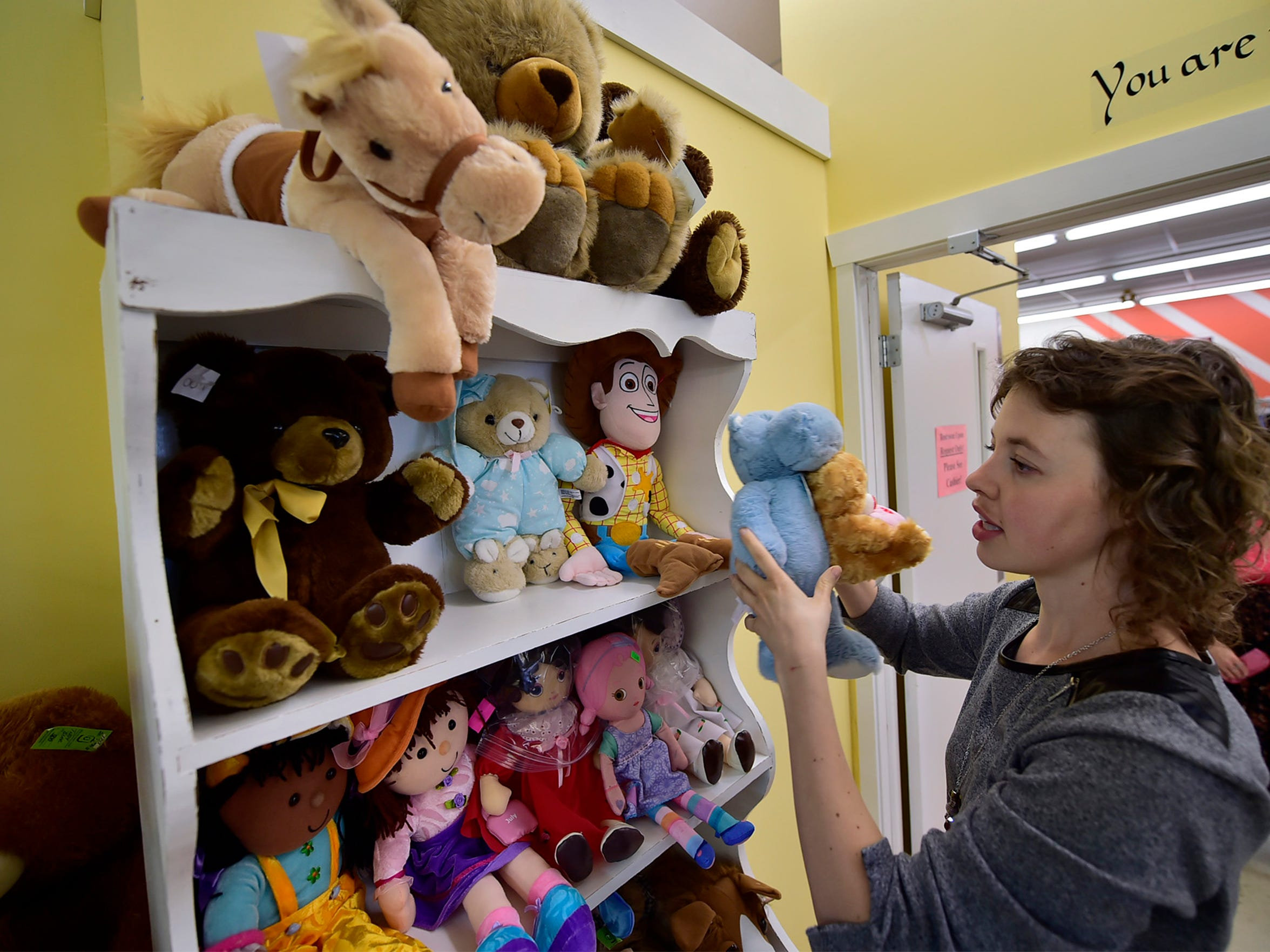 Naomi Raber, New Life Thrift Shop store manager, gets toys ready for the shelves on Thursday, June 7, 2018. The store is located at 39 Warm Spring Road, adjacent to Sunnyway Foods.