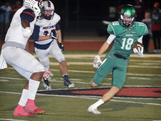 Iowa Park receiver Walker Bird (18) tries to get outside as Waxahachie defenders move in during second half action Friday night in Gainesville.