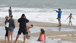 Crowds return to beach as Hermine moves out