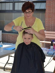 Joshua Noritsky, 8, of Millville gets a hair cut from