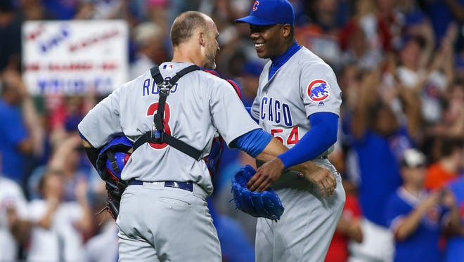 Chicago Cubs catcher David Ross (3) and relief pitcher Aroldis Chapman (54) - both former Reds - celebrate after the Cubs defeated  the Houston Astros 2-0 at Minute Maid Park on Sept. 9.
