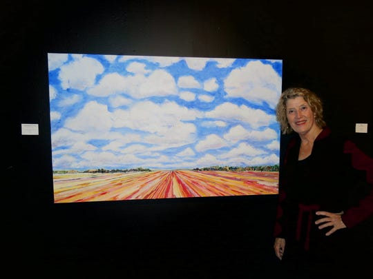 Artist Mary Louise Porter with one of her paintings