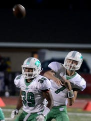 Novi quarterback Alex Bageris makes the pass attempt
