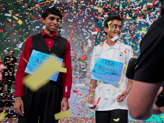 The 2014 Scripps National Spelling Bee Co-Champions Ansun Sujoe, left, of Fort Worth, Texas, and Sriram Hathwar, of Painted Post, N.Y., celebrate after winning the Scripps National Spelling Bee competition, Thursday, May 29, 2014, at National Harbor in Oxon Hill, Md.